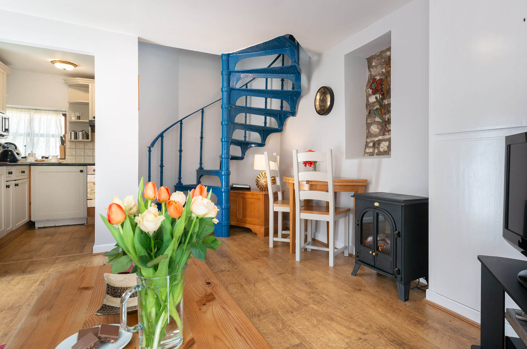 Courtyard Cottage Lounge and spiral stairs. A pet friendly holiday cottage.
