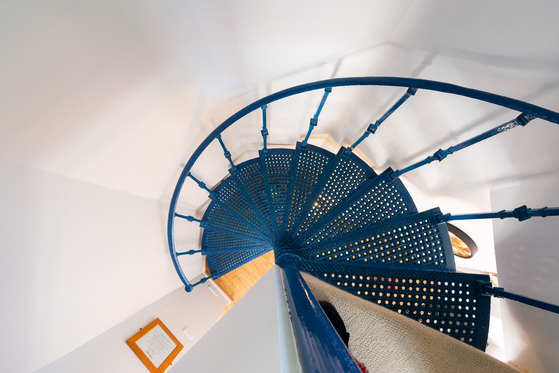 Courtyard Cottage spiral staircase. A pet friendly holiday cottage.